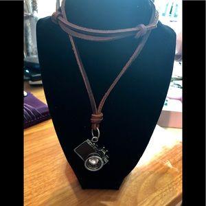 Leather camera necklace.